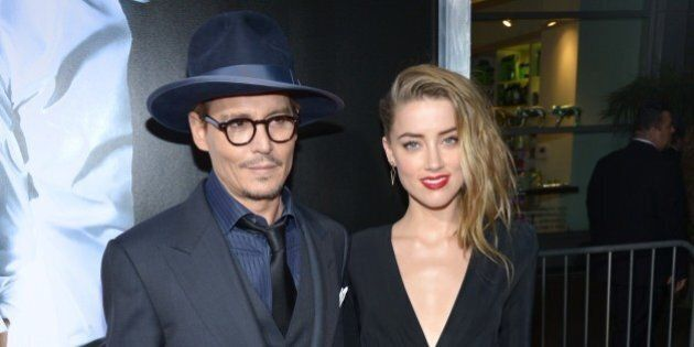 Johnny Depp, left, and Amber Heard arrive at the US premiere