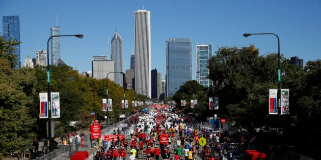 Runners walk through the finish area after completing the Chicago Marathon on Sunday, Oct. 13, 2013,...