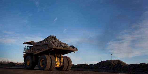 A 240-ton capacity production truck transports a load of taconite from an open pit mine to the Hibbing...