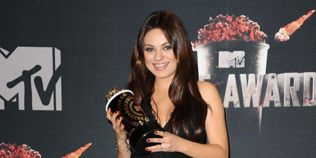 LOS ANGELES, CA - APRIL 13: Actress Mila Kunis poses in the press room at the 2014 MTV Movie Awards at...