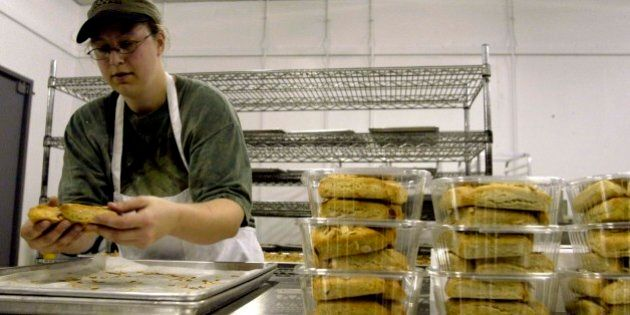 Nicole Delaney packages freshly baked almond scones, Tuesday, Oct. 5, 2004, at the Whole Foods Market Gluten-Free Bakehouse in Morrisville, N.C. A gluten-free diet is medically necessary for individuals diagnosed with celiac disease. (AP Photo/Karen Tam)