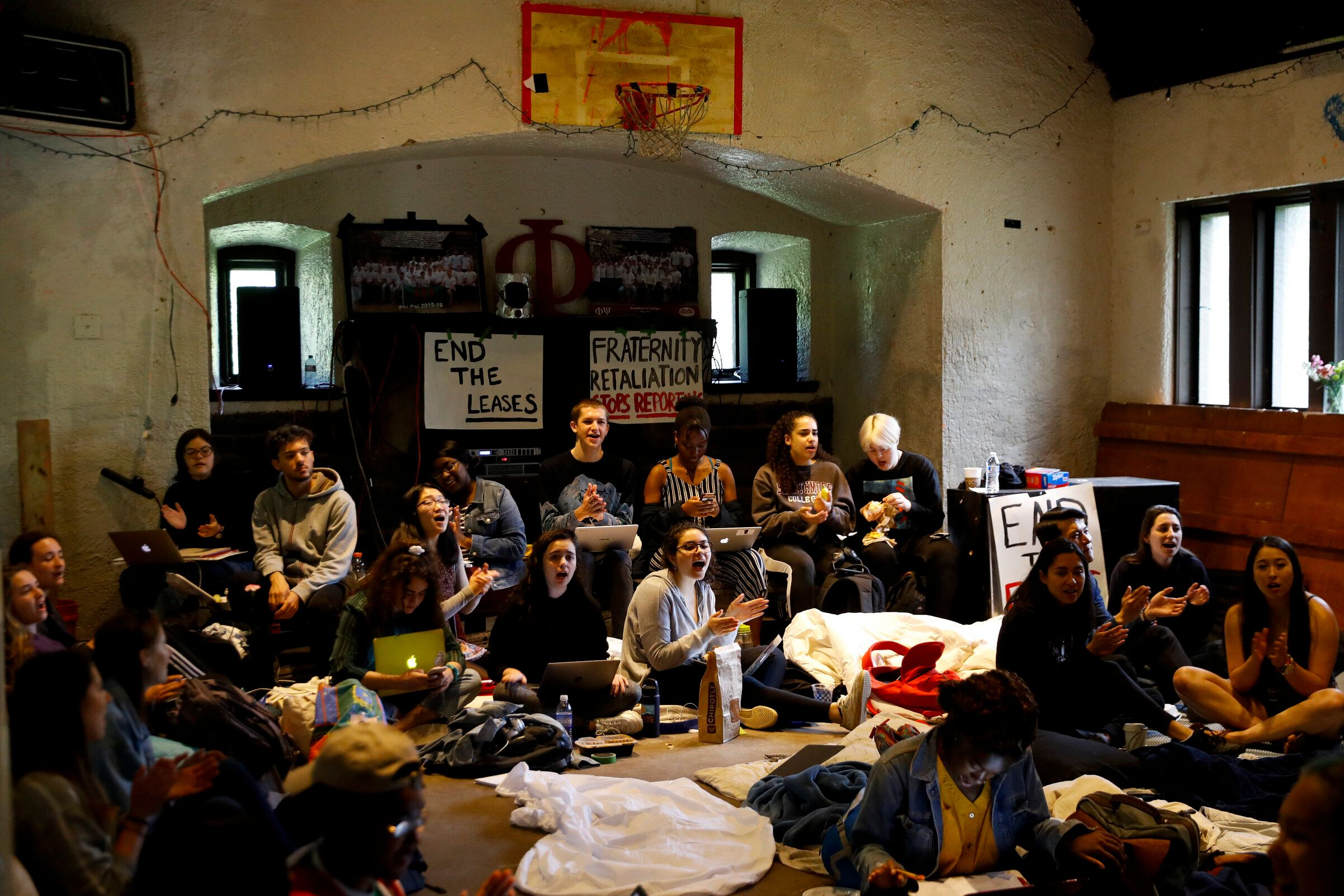 Swarthmore College students sing during a sit-in at the Phi Psi fraternity house, Monday, April 29, 2019, in Swarthmore, Pa. Students at the suburban Philadelphia college have occupied the on-campus fraternity house in an effort to get it shut down after documents allegedly belonging to Phi Psi surfaced this month containing derogatory comments about women and the LGBTQ community and jokes about sexual assault. (AP Photo)