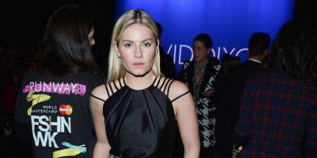 TORONTO, ON - OCTOBER 21: Elisha Cuthbert attends World MasterCard Fashion Week Spring 2014 Collections...