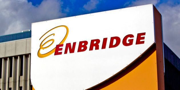 Enbridge Inc. signage is displayed outside of the company's corporate office in Toronto, Ontario, Canada, on Friday, Oct. 28, 2011. Enbridge Inc. provides energy transportation, distribution, operates crude oil and liquids pipeline systems, natural gas transmission for midstream businesses in North America and internationally. Photographer: Brent Lewin/Bloomberg via Getty Images