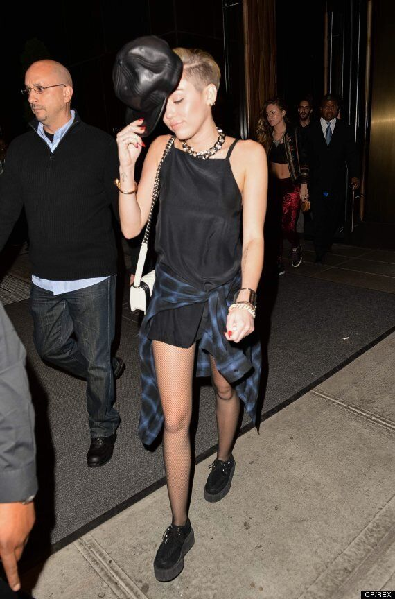 Miley Cyrus Looks Glam In Sequined Dress, Wild In Black Romper