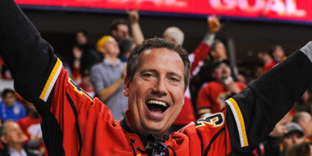 CALGARY, AB - MARCH 12: A fan of the Calgary Flames celebrates after a goal against the Anaheim Ducks...