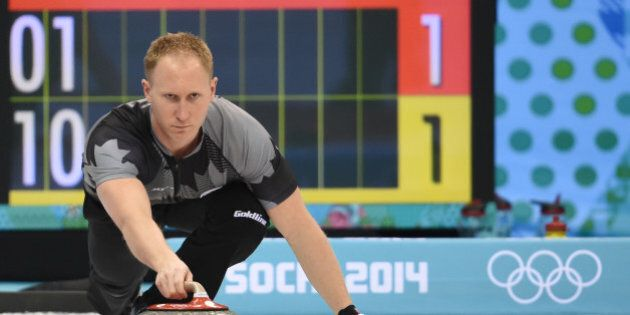 Canada's Brad Jacobs throws the stone during the Men's Curling Round Robin Session 7 at the Ice Cube...