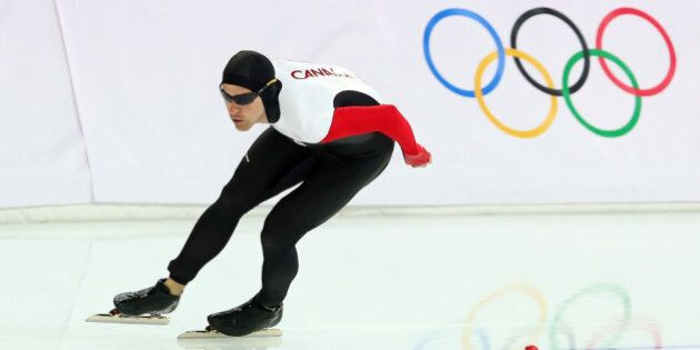 SOCHI, RUSSIA - FEBRUARY 15:  Denny Morrison of Canada competes in the Men's 1500m Speed Skating event on day 8 of the Sochi 2014 Winter Olympics at Adler Arena Skating Center on February 15, 2014 in Sochi, Russia.  (Photo by Quinn Rooney/Getty Images)