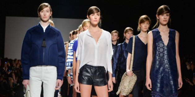 TORONTO, ON - OCTOBER 23: Models walk the runway wearing Joe Fresh spring 2014 collection during World...
