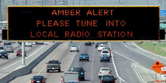 AMBER 1 / 05/14/05 -- Amber Alert is displayed on sign over westbound Highway 401 near Keele St. Police...