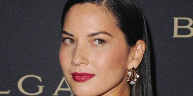 WEST HOLLYWOOD, CA - FEBRUARY 25: Actress Olivia Munn arrives at BVLGARI 'Decades Of Glamour' Oscar Party...