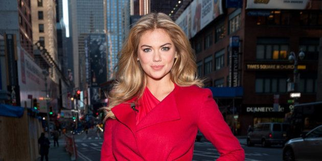 NEW YORK, NY - OCTOBER 24: Kate Upton visits 'Extra' in Times Square on October 24, 2013 in New York...