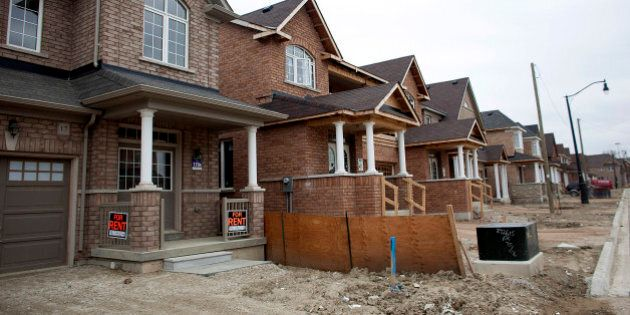Homes under construction stand at the Landscapes of Sandringham Community development in Brampton, Ontario,...