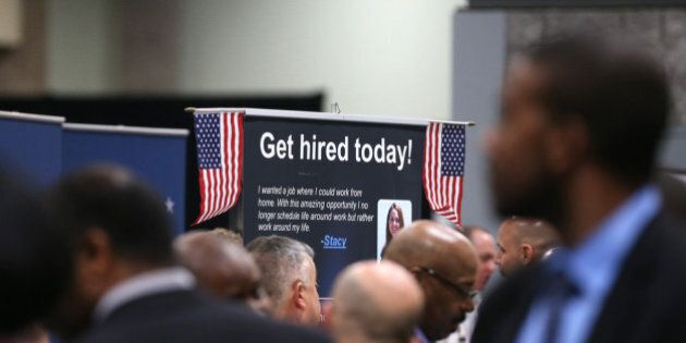 WASHINGTON, DC - JANUARY 10: People visit booths of prospective employers during the Hiring Our Heroes...