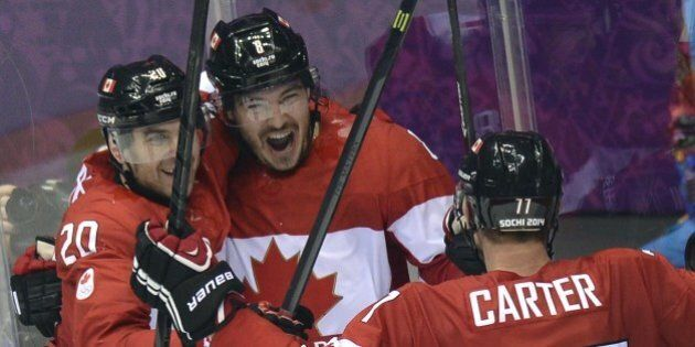 Canada's Drew Doughty (C) celebrates with teammates after scoring in overtime during the Men's Ice Hockey...