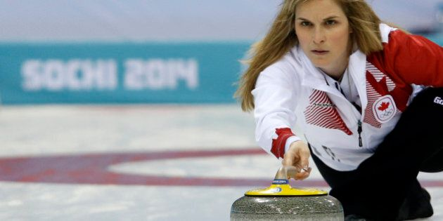 Canada's Skip Jennifer Jones throws a stone during the women's curling round robin session 10 match between...