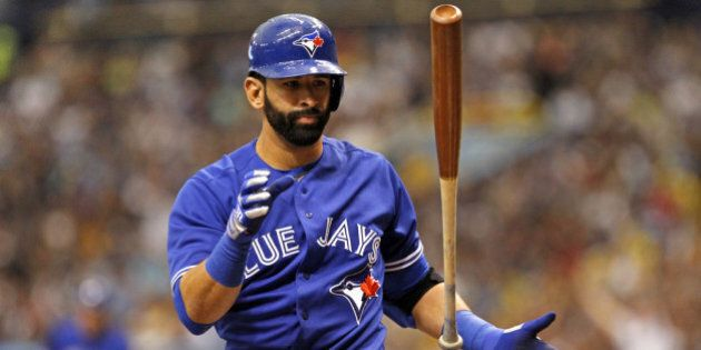ST. PETERSBURG, FL - MARCH 31: Jose Bautista #19 of the Toronto Blue Jays reacts after striking out swinging...