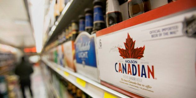 A six pack of Molson Coors Brewing Co. Canadian beer is displayed for sale at a supermarket in New York,...