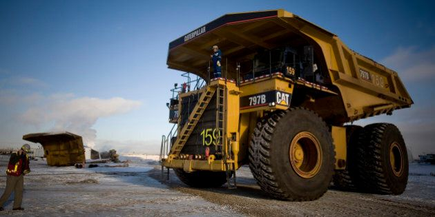 FORT MCMURRAY, ALBERTA, CANADA - NOVEMBER 2008: Caree Simms, 32, has been driving one of these trucks, the world's biggest, for the past 2 years. She earns over CAD $100,000 per year. Shell Albian Sands, is one of the biggest companies exploiting the tar sands in Alberta, northern Canada. Tar sands, or oil sands, are very dense and contain a form of petroleum The world's largest reserves of tar sands in Canada and Venezuela. Tar sands could equate to approximately two thirds of the total global petroleum resource. Until recently it was financially not viable to extract the oil from the sands, but new technology and rising oil prices have now made it viable. (Photo by Veronqiue de Viguerie/Getty Images)