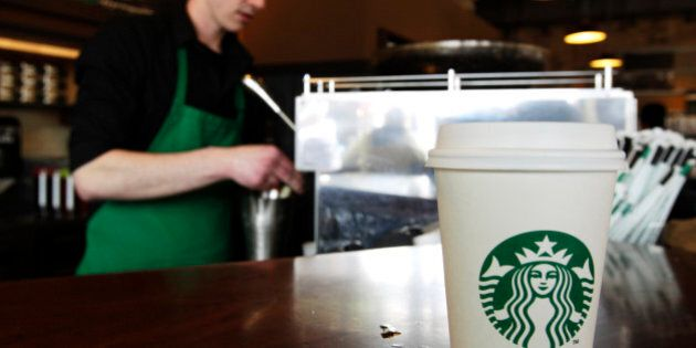 FILE - In this Friday, April 27, 2012, photo, a Starbucks drink waits for a customer to pick it up as...