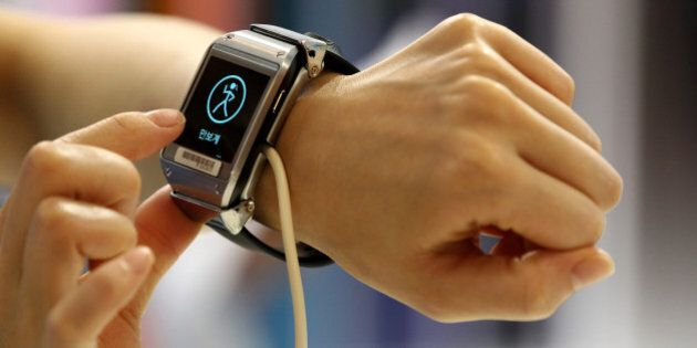 An event employee tries out a Samsung Electronics Co. Galaxy Gear smartwatch at the launch event for...