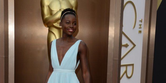 Nominee for Best Supporting Actress in '12 Years a Slave'  Lupita Nyong'o arrives on the red carpet for the 86th Academy Awards on March 2nd, 2014 in Hollywood, California. AFP PHOTO / Robyn BECK        (Photo credit should read ROBYN BECK/AFP/Getty Images)