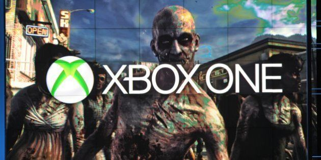 A frame from Dead Rising 3, exclusively for Xbox One, is seen under the Xbox One logo, at the Microsoft...