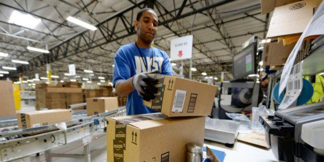 SAN BERNARDINO, OCTOBER 29: Employee Lamar Roby prepares shipping orders at Amazon's San Bernardino Fulfillment...