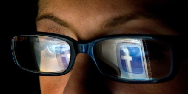 The Facebook Inc. logo is reflected in the eyeglasses of a user in San Francisco, California, U.S., on...