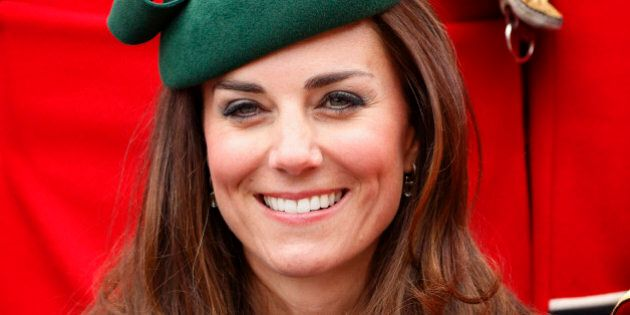 ALDERSHOT, UNITED KINGDOM - MARCH 17: (EMBARGOED FOR PUBLICATION IN UK NEWSPAPERS UNTIL 48 HOURS AFTER CREATE DATE AND TIME) Catherine, Duchess of Cambridge poses for a group photograph with soldiers of the Irish Guards as she attends the St Patrick's Day Parade at Mons Barracks on March 17, 2014 in Aldershot, England. Catherine, Duchess of Cambridge and Prince William, Duke of Cambridge visited the 1st Battalion Irish Guards to present the traditional sprigs of Shamrocks to the Officers and Guardsmen of the Regiment. (Photo by Max Mumby/Indigo/Getty Images)