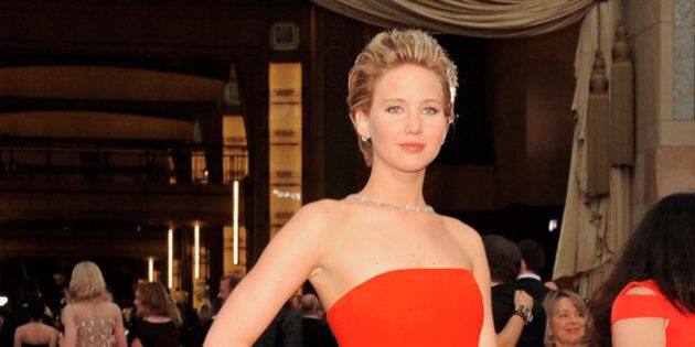 Jennifer Lawrence arrives at the Oscars on Sunday, March 2, 2014, at the Dolby Theatre in Los Angeles.  (Photo by Chris Pizzello/Invision/AP)