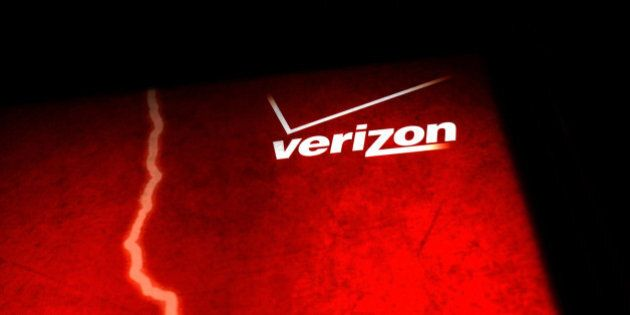 NEW YORK, NY - JUNE 07: A Verizon advertisement is viewed outside of a store on June 7, 2013 in New York...