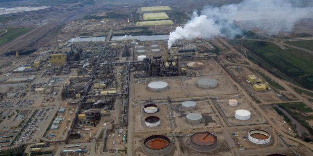 Oil is refined at a Syncrude Canada Ltd. mining site near Fort McMurray, Alberta, Canada, on Tuesday,...