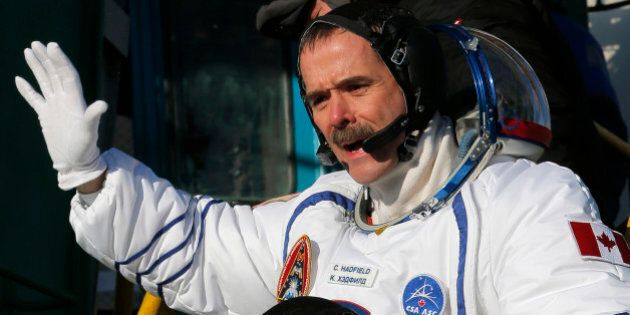 Canadian astronaut Chris Hadfield, a crew member of the mission to the International Space Station, gestures...
