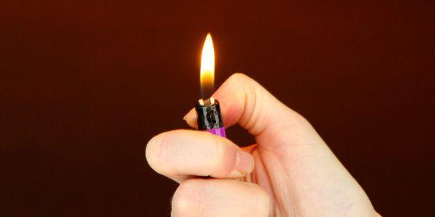 burning lighter in female hand