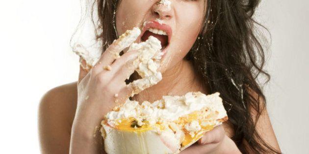 girl eats fruit cake