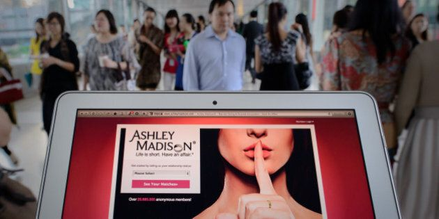 TO GO WITH AFP STORY LIFESTYLE-HONG KONG-INTERNET-SEX, FOCUS by Aaron TamThis photo illustration taken on August 20, 2013 shows the homepage of the Ashley Madison dating website displayed on a laptop in Hong Kong. The founder of a dating service promoting adultery is setting his sights on China's cheating hearts after a controversial launch in Hong Kong.  AFP PHOTO / Philippe Lopez        (Photo credit should read PHILIPPE LOPEZ/AFP/Getty Images)