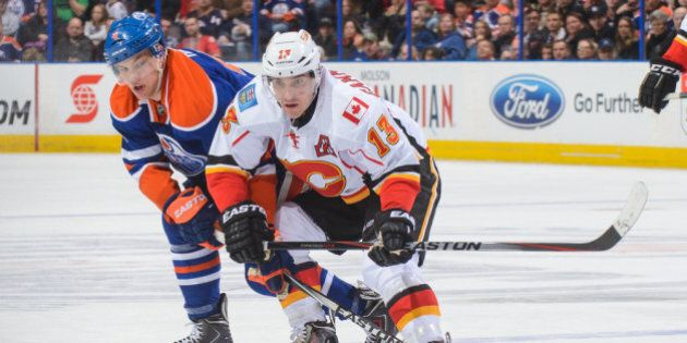 EDMONTON, AB - MARCH 22: Taylor Hall #4 of the Edmonton Oilers tries to check Mike Cammalleri #13 of the Calgary Flames during an NHL game at Rexall Place on March 22, 2014 in Edmonton, Alberta, Canada. (Photo by Derek Leung/Getty Images)