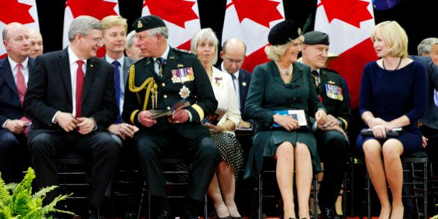 Britain's Prince Charles talks with Canada's Prime Minister Stephen Harper (L) while Duchess of Cornwall Camilla (2nd R) speaks with Harper's wife Laureen (R) at the Fort York Armoury for the 1812 Commemorative Military Muster in  Toronto, May 22, 2012. The Prince of Wales and his wife Camilla, the Duchess of Cornwall, are on a three-day royal tour of Canada as part of the events that mark the Queen's Diamond Jubilee 2012.     AFP PHOTO / Pool / Mark Blinch        (Photo credit should read MARK BLINCH/AFP/GettyImages)
