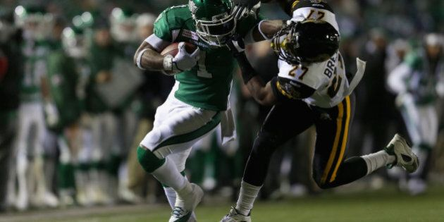 REGINA, SK - NOVEMBER 24: Runningback Kory Sheets #1 of the Saskatchewan Roughriders breaks the tackle...