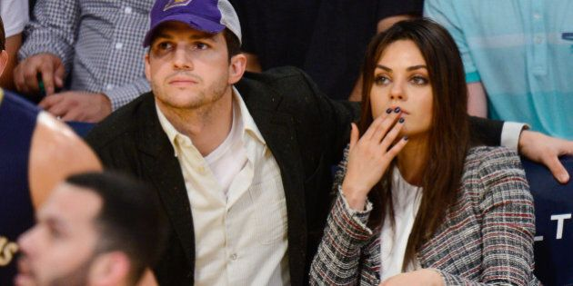 LOS ANGELES, CA - MARCH 04: Ashton Kutcher (L) and Mila Kunis attend a basketball game between the New...