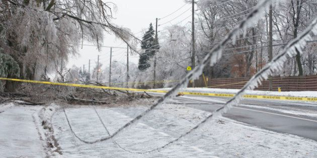 TORONTO, ON - DECEMBER 22: Leslie Street south of York Mills was closed after the ice storm brought down power lines Sunday afternoon. Lucas Oleniuk/Toronto Star        (Lucas Oleniuk/Toronto Star via Getty Images)
