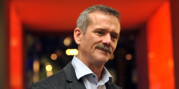 LONDON, ENGLAND - DECEMBER 16: Astronaut Chris Hadfield poses for photos in front of the Apollo 10 Command...