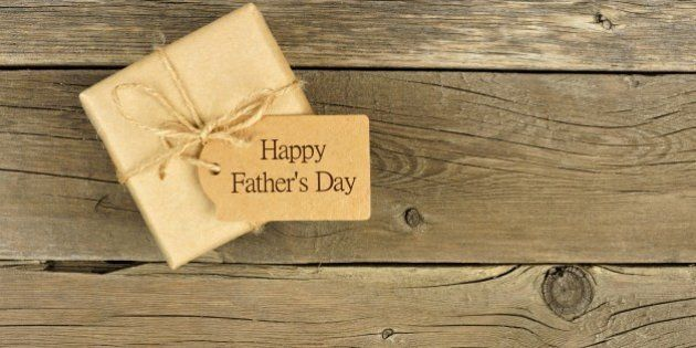 Brown Fathers Day gift box with tag on a rustic wood