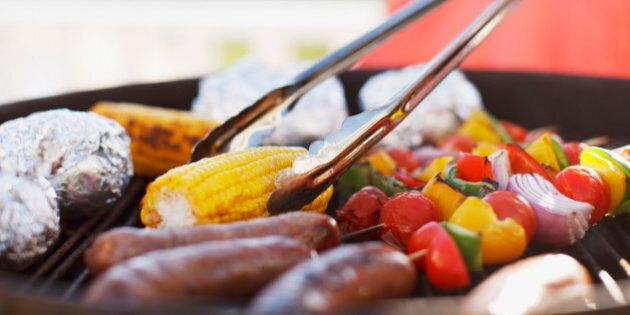 Close up of man grilling food on
