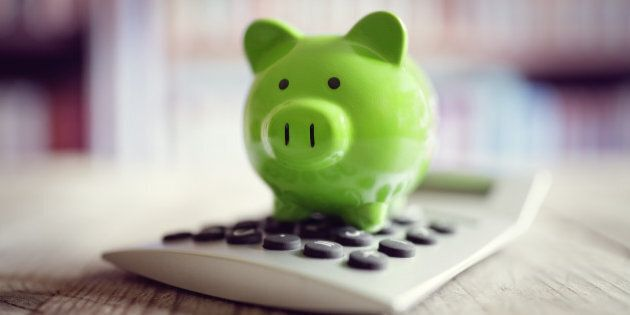 Piggy bank on calculator concept for saving, accounting, banking and business