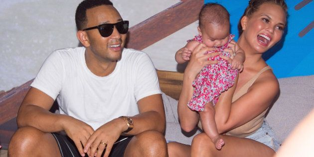 BROOKLYN, NY - AUGUST 28: Model Chrissy Teigen and musician John Legend with their baby Luna Simone Stephens...
