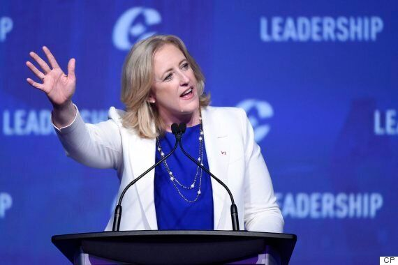 Lisa Raitt waves to the crowd during the opening night of the federal Conservative leadership convention...