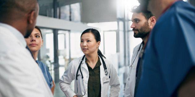 Shot of a diverse team of doctors having a