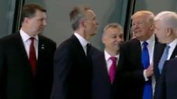 Trump Shoves Grown Man To Stand In Front Of Group Of